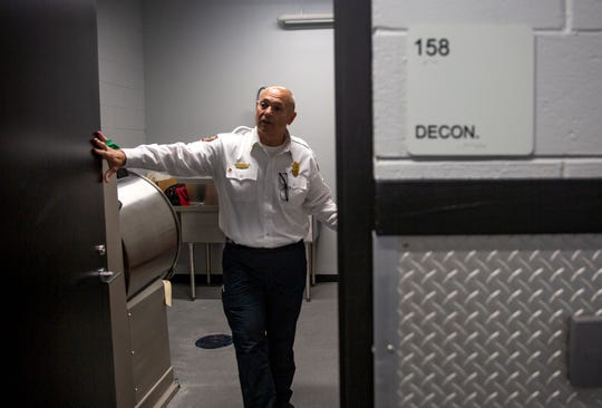 Naples Fire Chief Pete DiMaria talks about the fire station's new decontamination room during a tour, Thursday, May 16, 2019, at the new Naples Fire Department Station No 1.