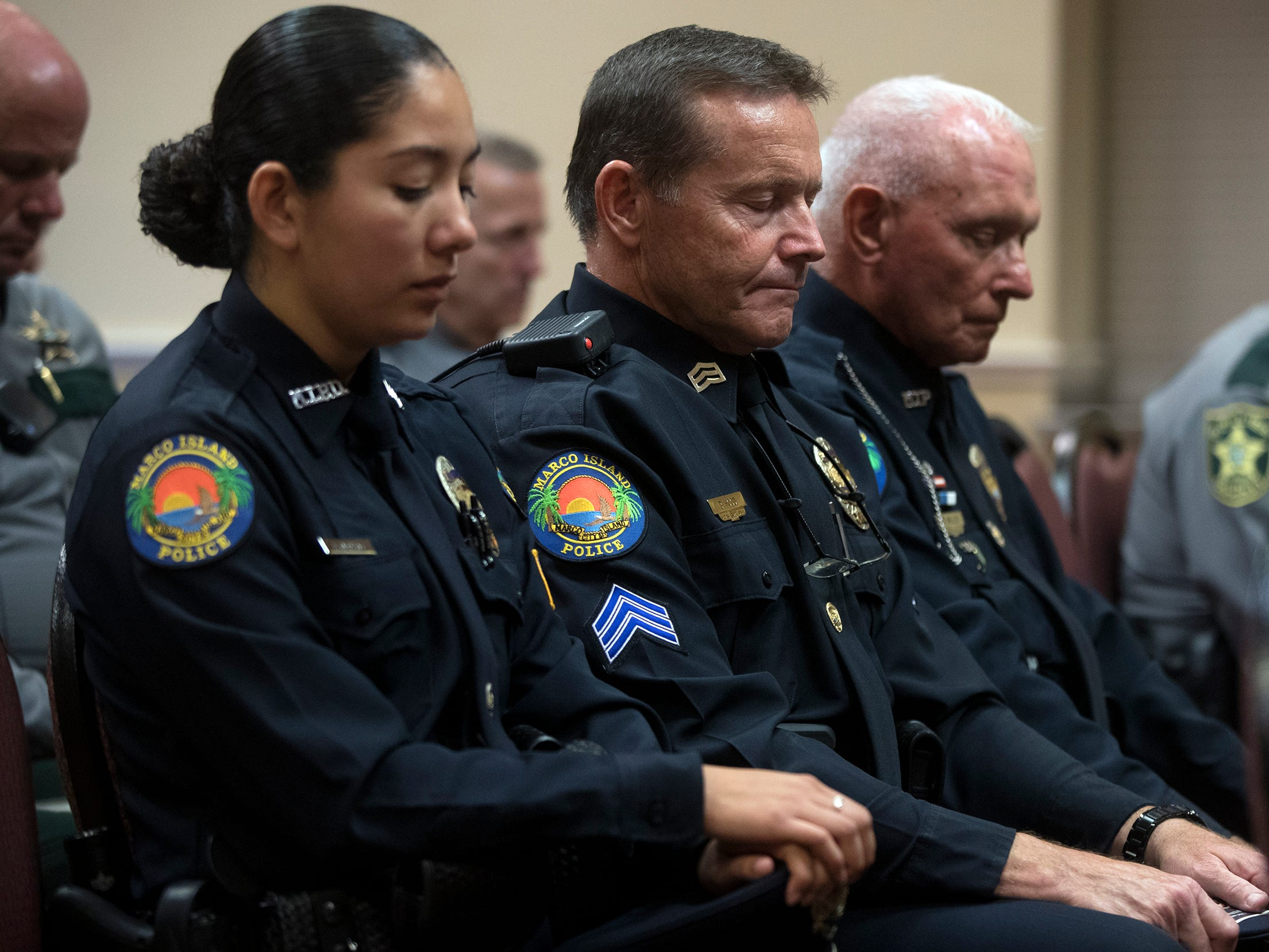 Officer Alejandra Moreno, left, and Sergeant Brian Hood, center, of the Marco Island Police Department, were among those honoring local law enforcement officers killed in the line of duty at a memorial on Wednesday at East Naples United Methodist Church. Thirteen officers have been killed in Collier County since 1928.