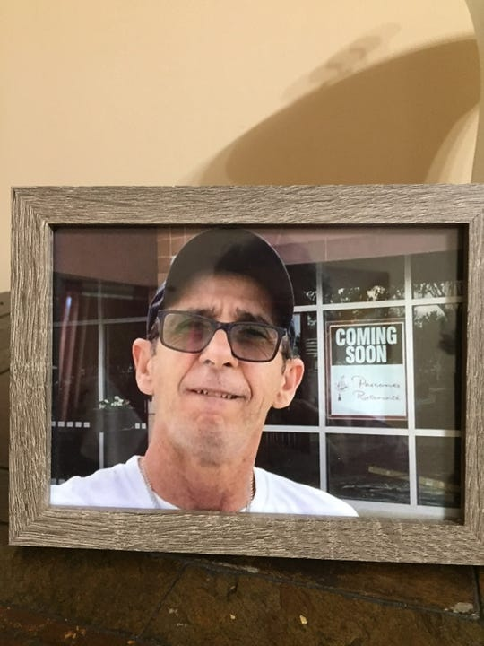 A framed photo of Sergio Hostins outside the Italian restaurant he worked at near Sarasota sits in the home of Teresa Giani on May 16, 2019. Hostins was killed about six months after he moved down to Florida from Maine.