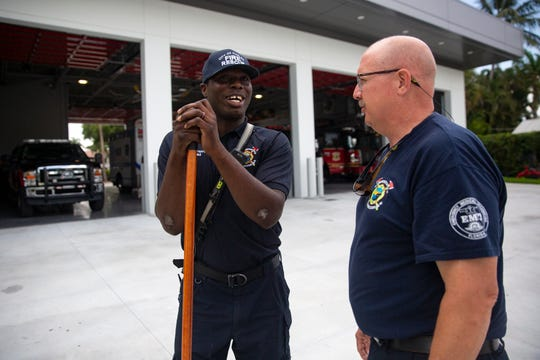 Naples Firefighter Johnson Paul, left, talks with Deputy Chief Mike Nichols, Thursday, May 16, 2019, at the Naples Fire Department Station No. 1.