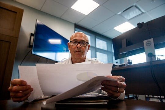 Naples Fire Chief Pete DiMaria looks over papers during an interview, Thursday, May 16, 2019, at the Naples Fire Department Station No.1.