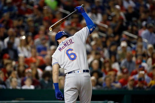 New York Mets' Jeff McNeil reacts after striking out in the fifth inning of a baseball game against the Washington Nationals, Wednesday, May 15, 2019, in Washington. Washington won 5-1.