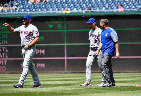 New York Mets right fielder Michael Conforto (30) leaves the game after an apparent injury during the fifth inning against the Washington Nationals at Nationals Park. Mandatory Credit: