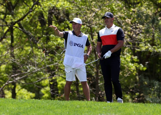 May 16, 2019; Bethpage, NY, USA; Brooks Koepka and his caddie Ricky Elliott on the 8th tee during the first round of the PGA Championship golf tournament at Bethpage State Park - Black Course.