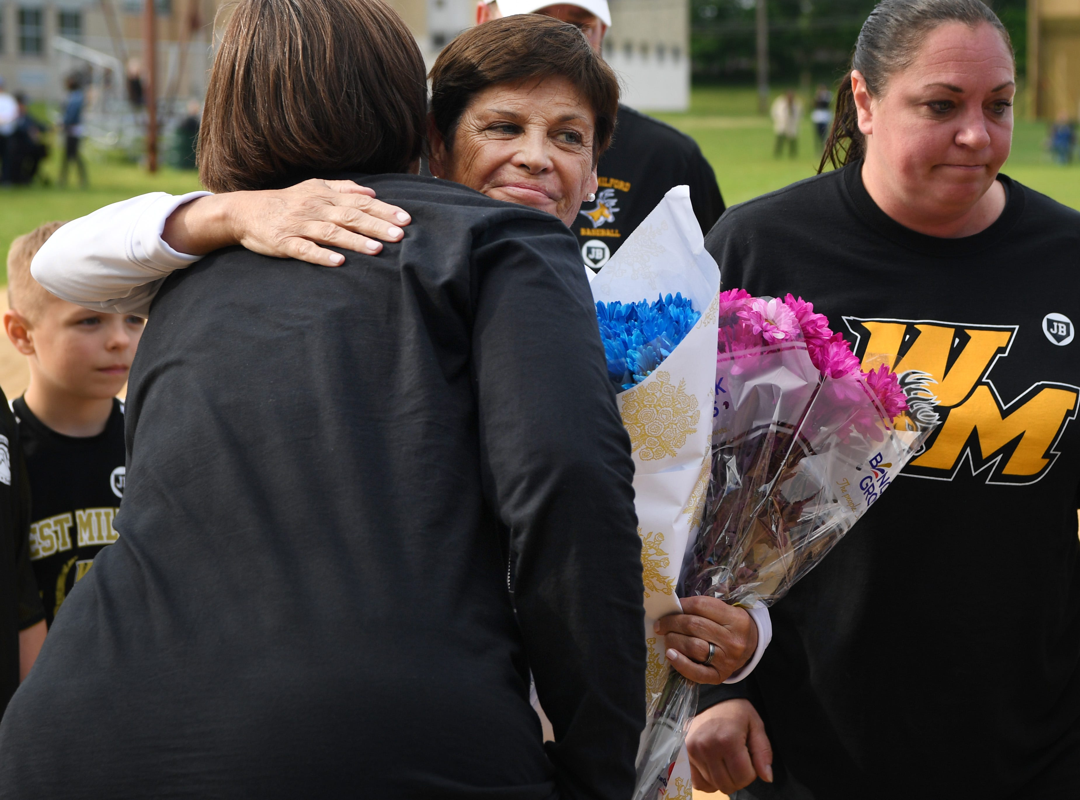 Passaic County Technical Institute vs. West Milford in the Passaic County Tournament softball final at Wayne Hills High School on Wednesday, May 15, 2019. Suzanne Busch gets a hug after a ceremony at home plate for her husband, umpire Jim Busch, who died in his sleep last Friday.