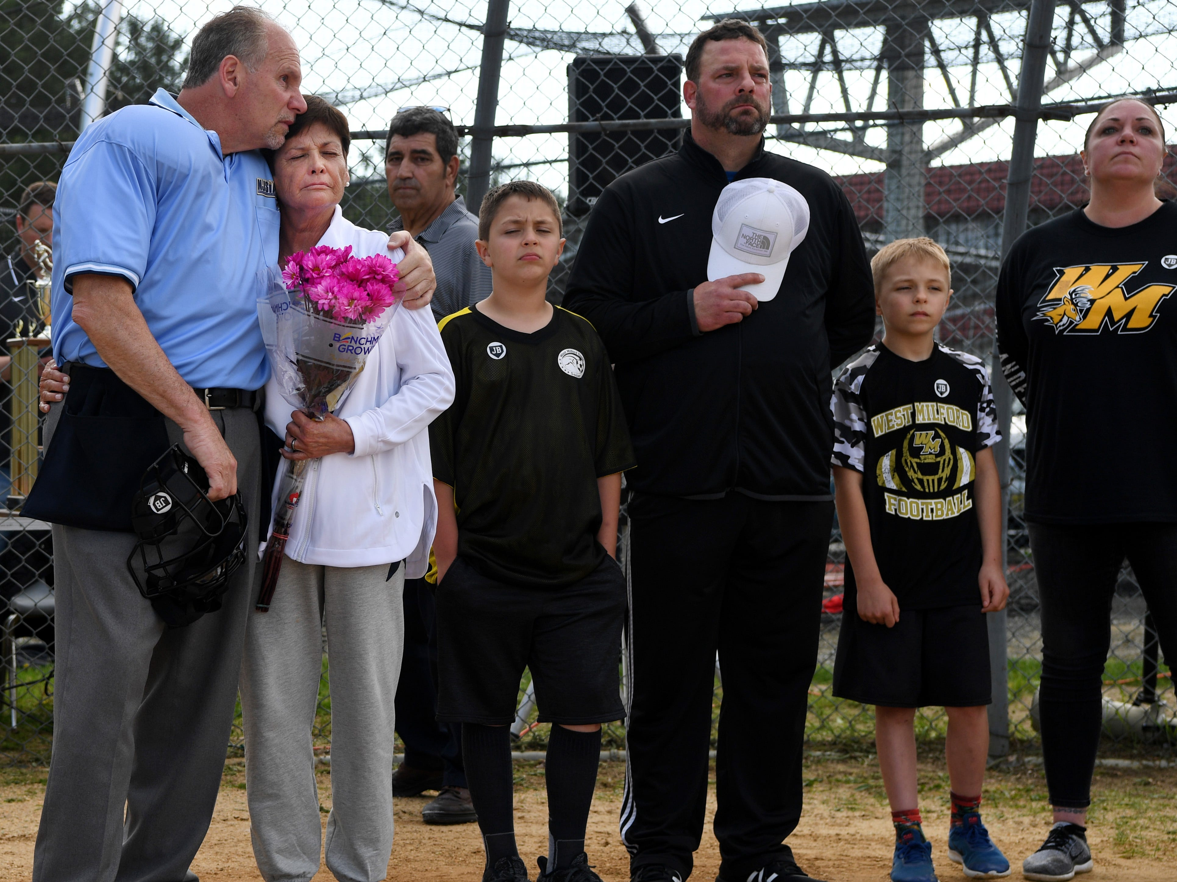 Passaic County Technical Institute vs. West Milford in the Passaic County Tournament softball final at Wayne Hills High School on Wednesday, May 15, 2019. (second from left) Suzanne Busch during a ceremony at home plate for her husband, umpire Jim Busch, who died in his sleep last Friday.