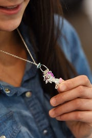 Zaina Matahen wears a unicorn necklace in honor of her friend  Miranda Vargas, who did not survive the bus crash last year. Shown in her Paramus home on Thursday May 16, 2019.