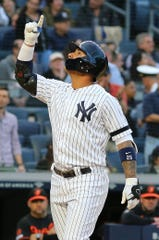 May 15, 2019; Bronx, NY, USA; New York Yankees shortstop Gleyber Torres (25) reacts after hitting a solo home run against the Baltimore Orioles during the fourth inning of game two of a doubleheader at Yankee Stadium.