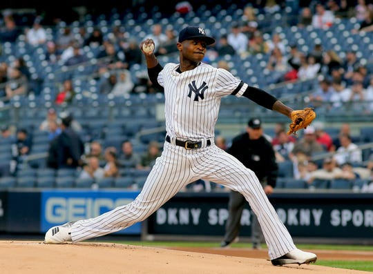 May 15, 2019; Bronx, NY, USA; New York Yankees starting pitcher Domingo German (55) delivers a pitch against the Baltimore Orioles during the first inning of game two of a doubleheader at Yankee Stadium.