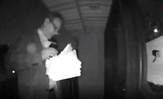 Screen grab of the surveillance video that recorded Councilman Harry Kumburis knocking on doors on election night.
