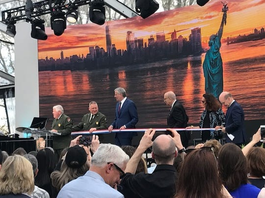 Dedication Ceremony for Statue of Liberty Museum held May 16, 2019 at Liberty Island. New York City Bill de Blasio helps cut the ribbon during ceremony.