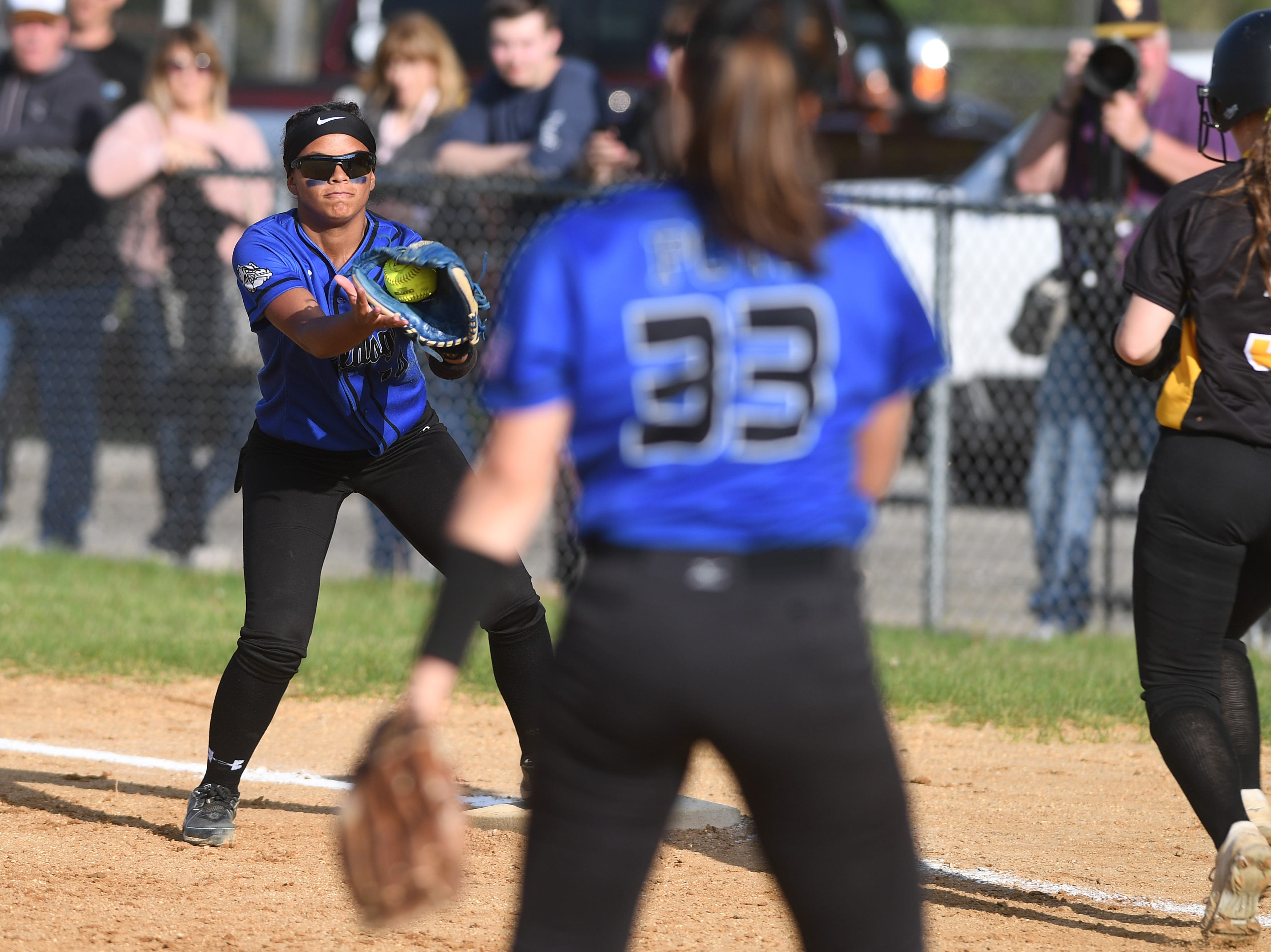 Passaic County Technical Institute vs. West Milford in the Passaic County Tournament softball final at Wayne Hills High School on Wednesday, May 15, 2019. PCTI #14 Geneen Garner gets the out at first.
