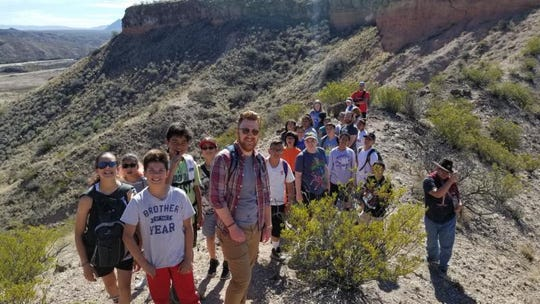 Patrick Nolan, center, with a group within Organ Mountains-Desert Peaks National Monument.