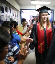 Samantha Parr high fives students at Hillrise Elementary School in Las Cruces, during a senior walk Thursday May 16, 2019.
