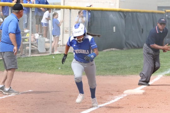 Cavegirl Marissa Reyes runs home to score the first run of Thursday's game against Cleveland.
