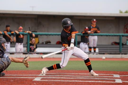 Centennial's Alex Flores makes contact at the plate against Piedra Vista during Thursday's 5A state baseball quarterfinals at Santa Ana Star Field in Albuquerque.