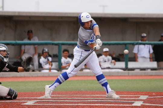 Carlsbad's Brendan Lopez makes contact at the plate against Volcano Vista during Thursday's 5A state baseball quarterfinals at Santa Ana Star Center in Albuquerque.