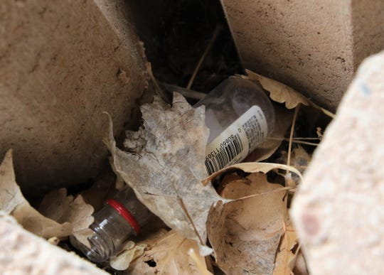 A miniature liquor bottle is hidden on May 16, 2019, in a concrete block at Boyd Park in Farmington, New Mexico.