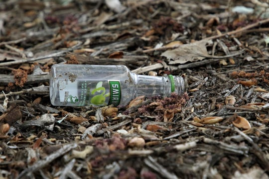 A miniature liquor bottle is seen on the ground on May 16, 2019, in Boyd Park in Farmington, New Mexico.