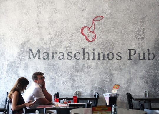 Maraschinos Pub's wall with its logo mural.