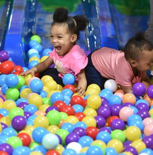 Amora McGlory runs into her brother Amari at Yoyo's Fun Center in the plastic ball pit on May 15, 2019. The siblings were there with their mother Shayla and her friend Brittany Morgan.