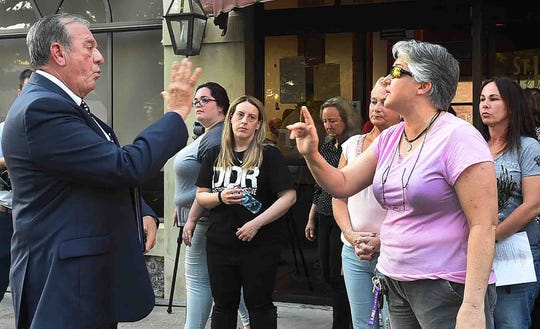 Animal rights activists confront St. Landry Parsih Sheriff Bobby Guidroz outside the Old City Market during Wednesday's parish council meeting.