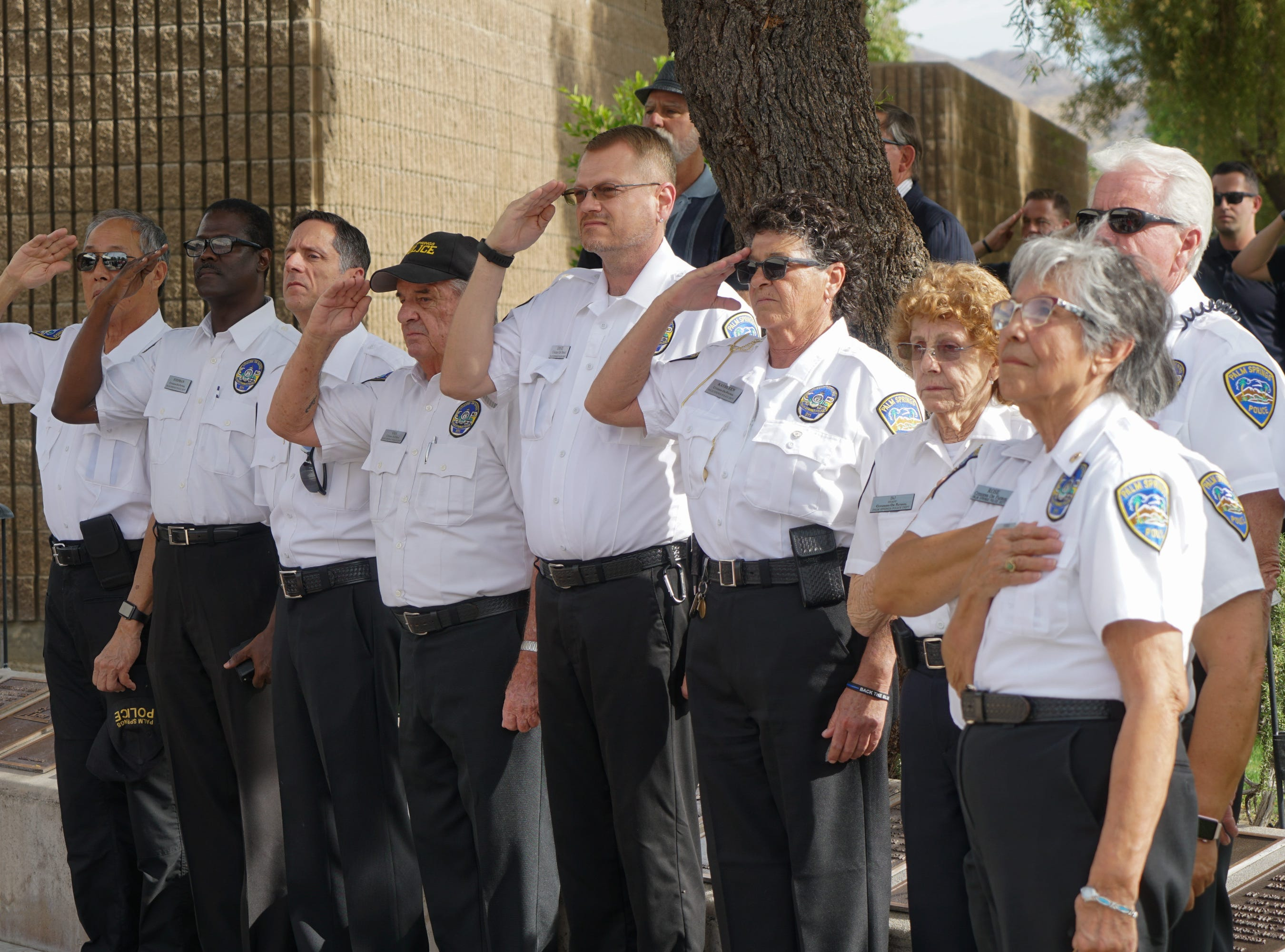 Palm Springs Citizens on Patrol stand for the national anthem during a ceremony to honor fallen officers on Peace Officers Memorial Day, Palm Springs, Calif., May 15, 2019.
