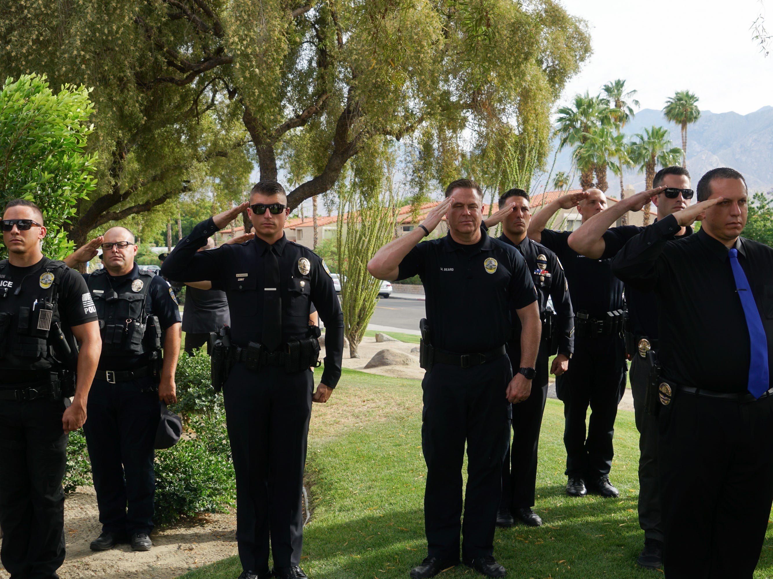 Officers stand for a gun salute during a ceremony honoring fallen Palm Springs police officers are on Peace Officers Memorial Day, Palm Springs, Calif., May 15, 2019.
