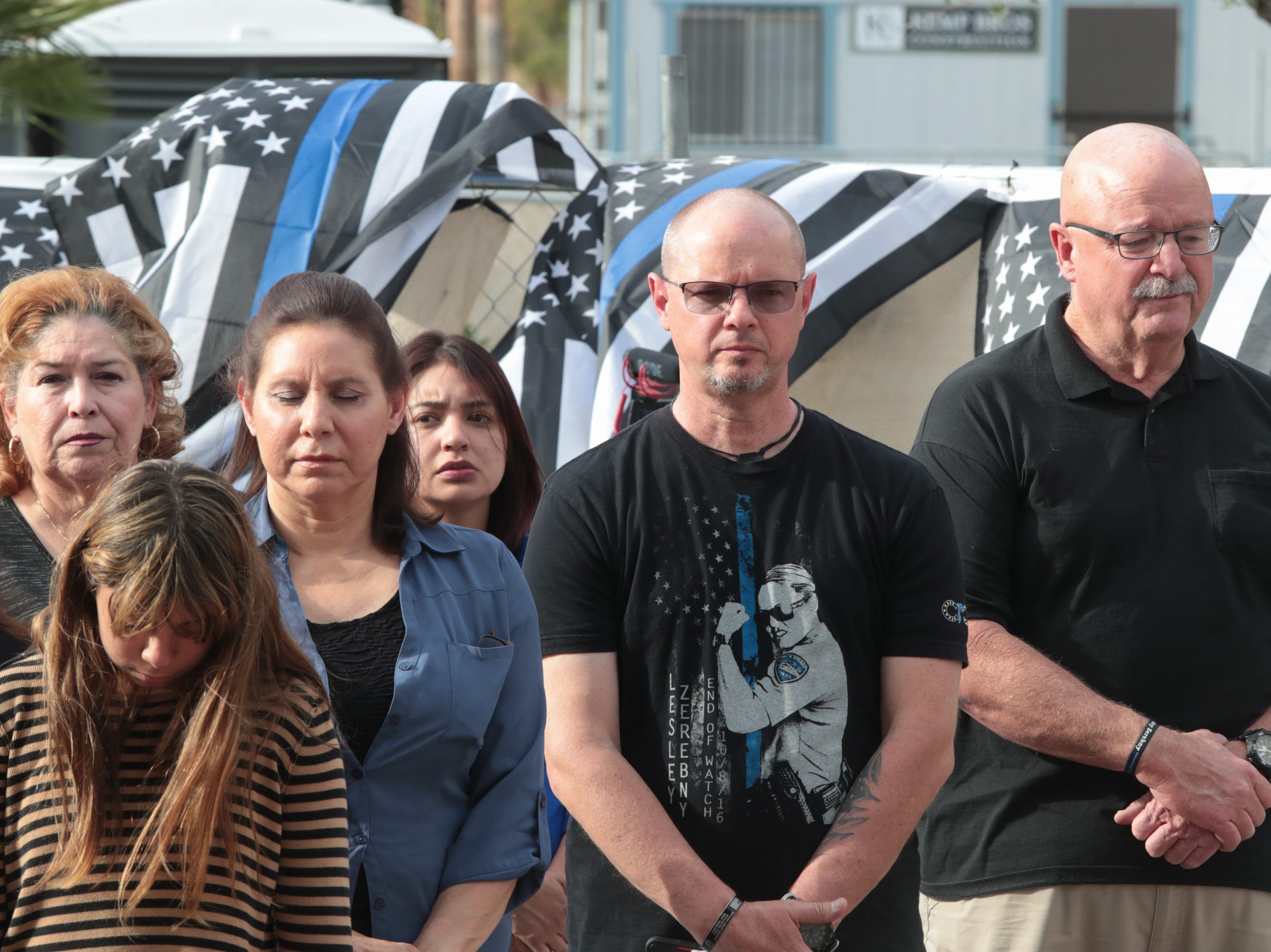 Family members, including Officer Vega's daughter and wife and Officer Zerebny's father -in-law and father, attend a ceremony honoring fallen Palm Springs police officers on Peace Officers Memorial Day, Palm Springs, Calif., May 15, 2019.