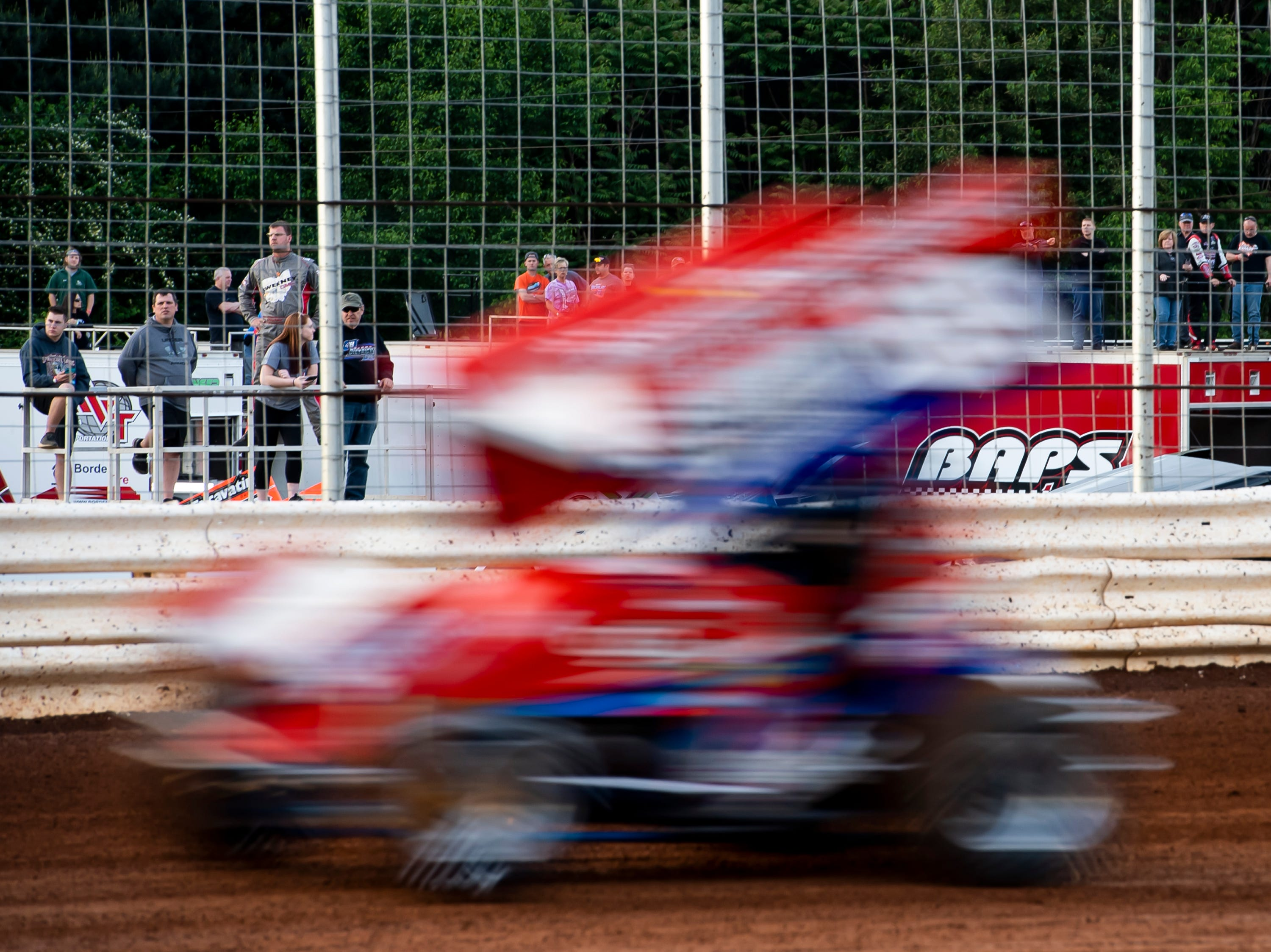 People watch as a car speeds past in the time trials during the World of Outlaws Gettysburg Clash at Lincoln Speedway in Abbottstown on Wednesday, May 15, 2019.