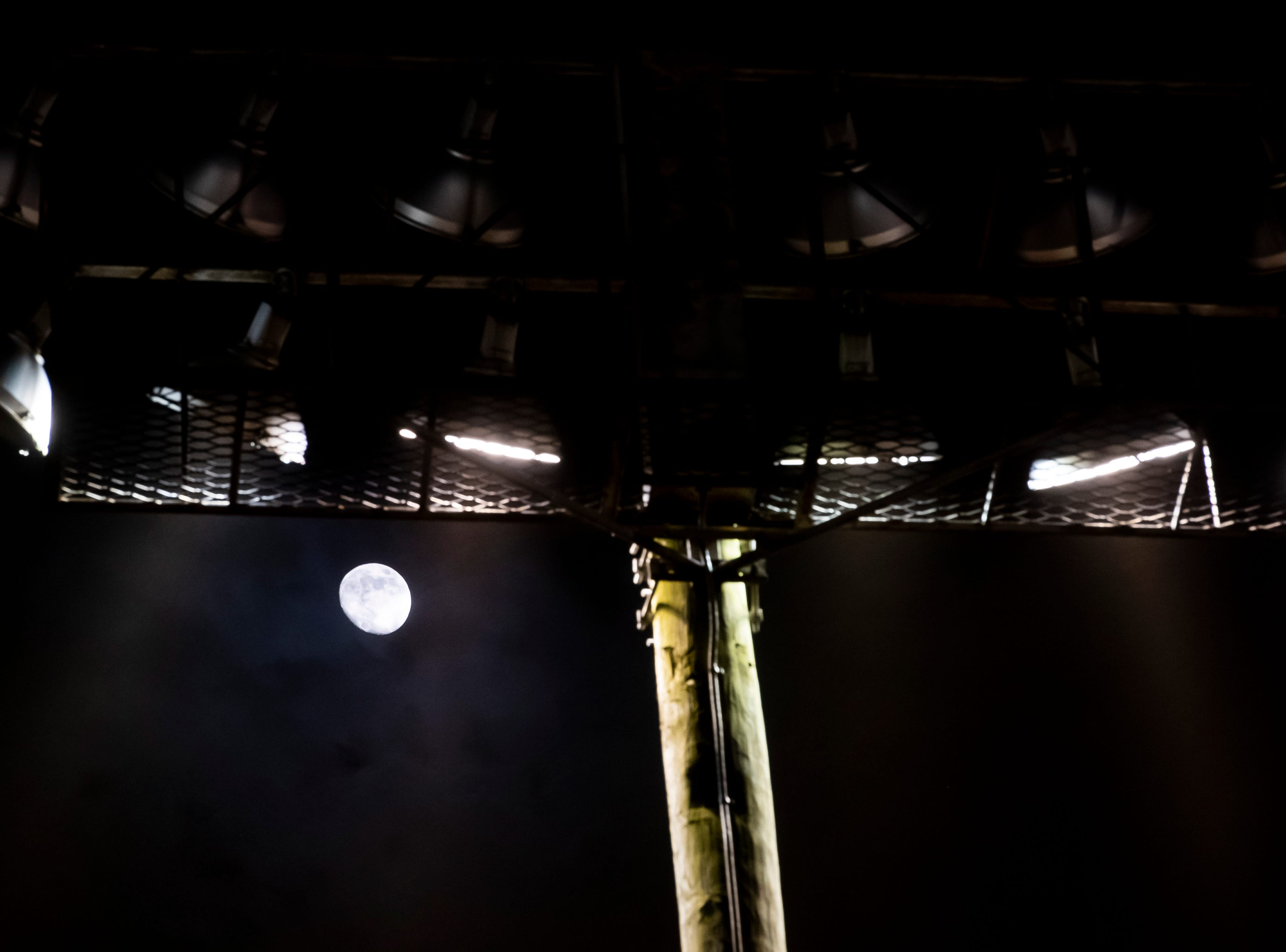 Clouds of dust pass in front of a light as the moon rises during the World of Outlaws Gettysburg Clash at Lincoln Speedway in Abbottstown on Wednesday, May 15, 2019.