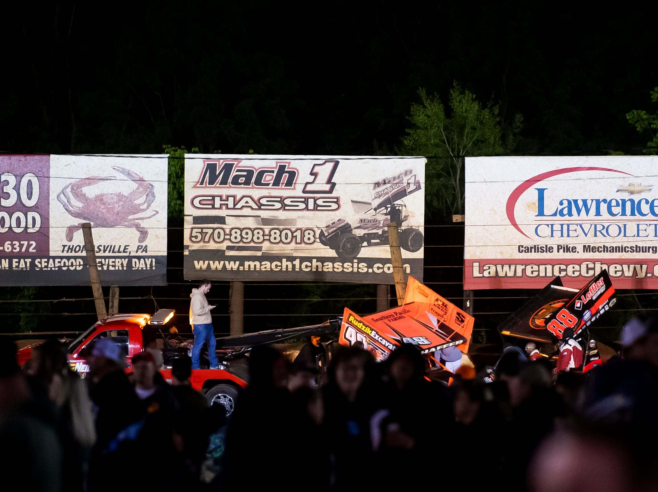Tim Shaffer's 49X car and Brandon Rahmer's 88 car are towed off the track following a wreck in the feature race during the World of Outlaws Gettysburg Clash at Lincoln Speedway in Abbottstown on Wednesday, May 15, 2019.
