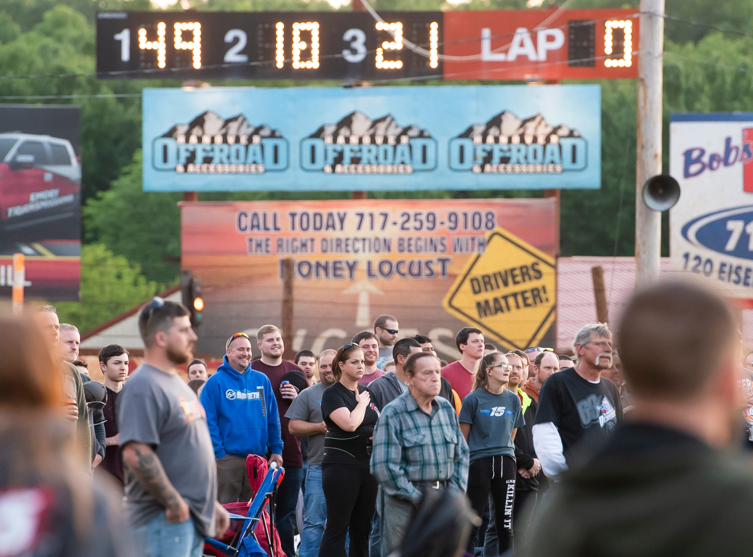 Spectators observe the national anthem before the start of races during the World of Outlaws Gettysburg Clash at Lincoln Speedway in Abbottstown on Wednesday, May 15, 2019.