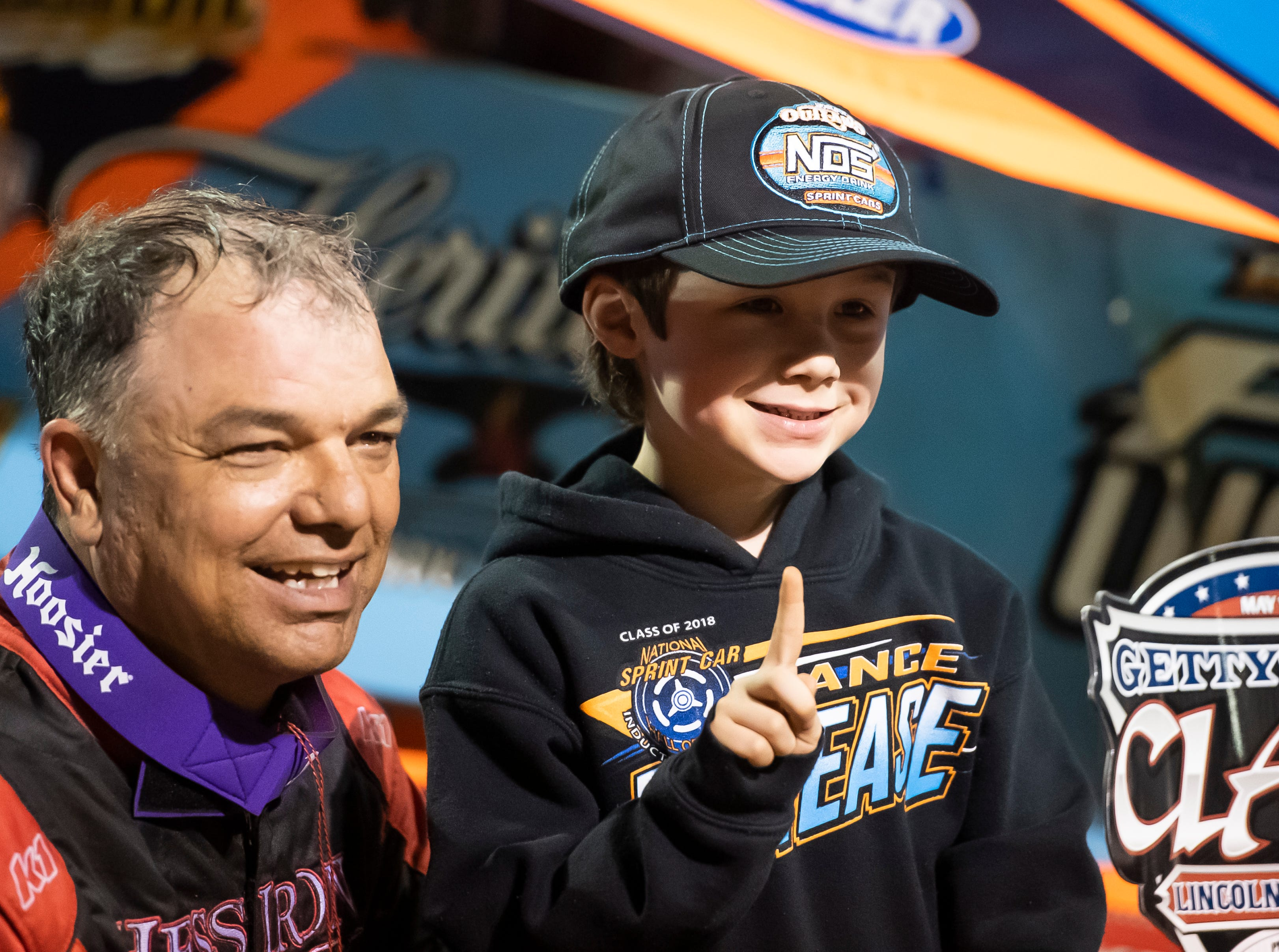 Hunter Smith, 6, of Waynesboro, gets a photo with Lance Dewease after the World of Outlaws Gettysburg Clash at Lincoln Speedway in Abbottstown on Wednesday, May 15, 2019.