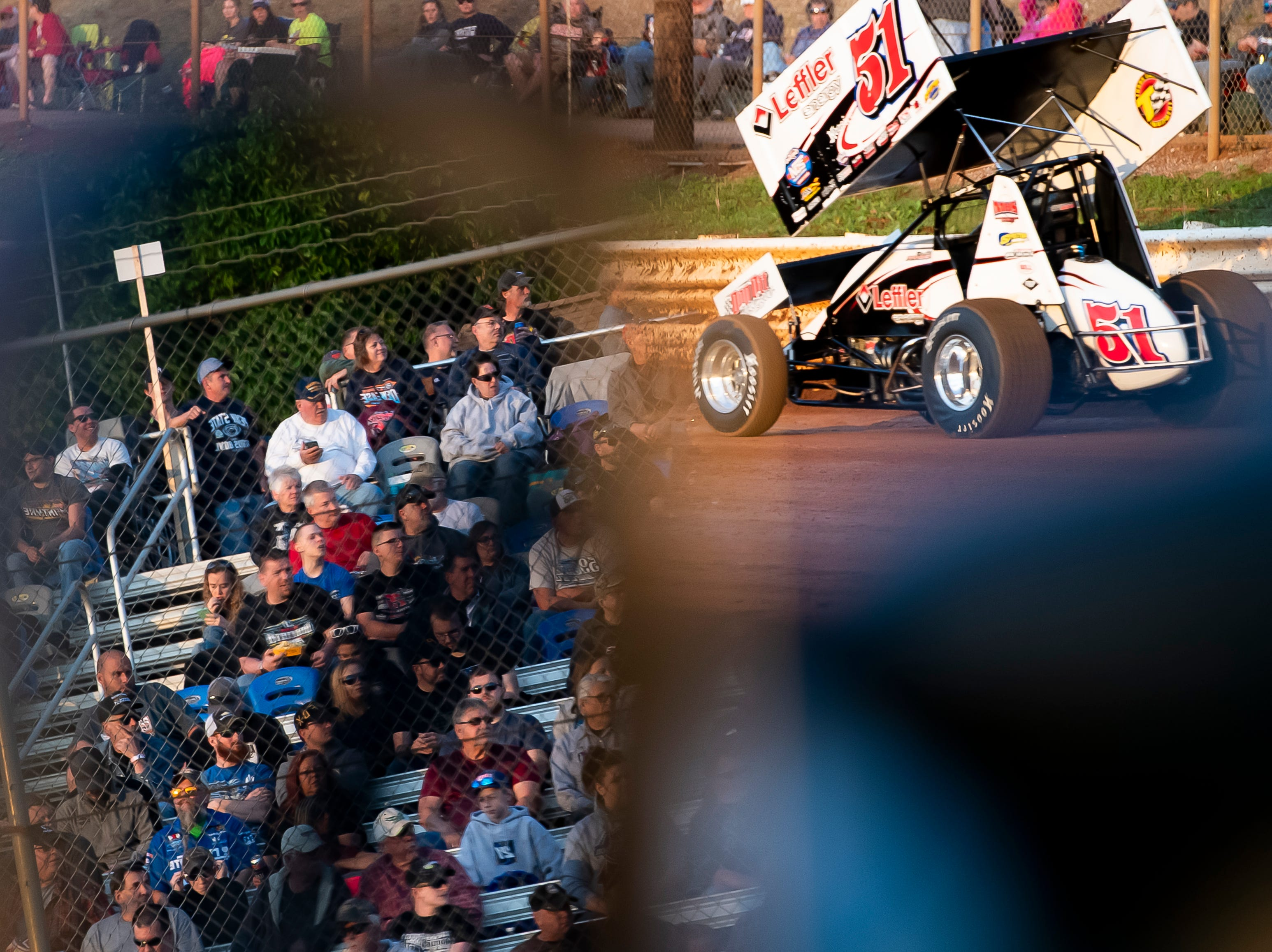 Spectators in the stands are reflected in a truck's mirror as Freddie Rahmer in the number 51 car drives in the time trials during the World of Outlaws Gettysburg Clash at Lincoln Speedway in Abbottstown on Wednesday, May 15, 2019.