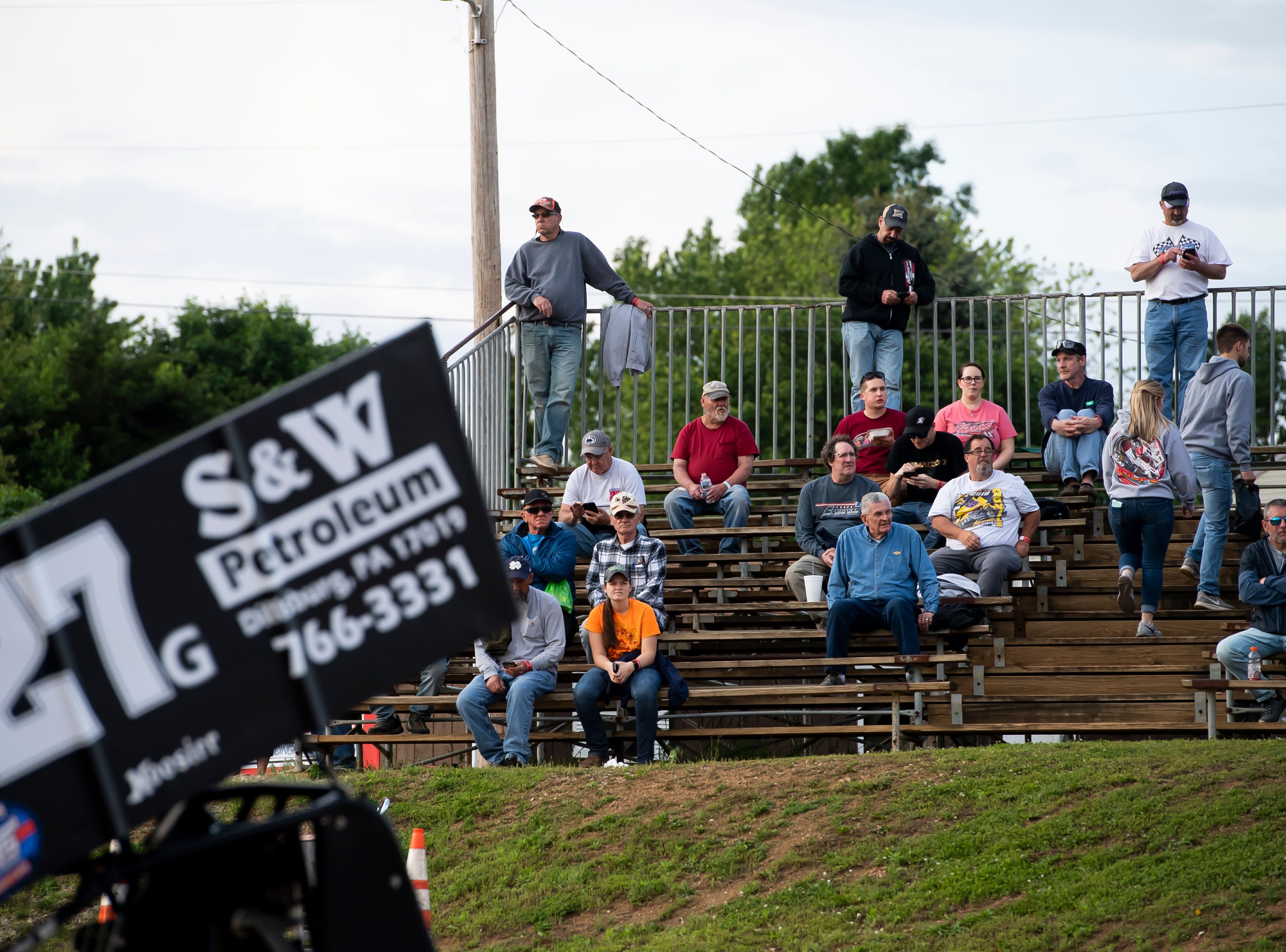 Spectators fill the stands as Jay Gallow and the 27G car races in the time trials during the World of Outlaws Gettysburg Clash at Lincoln Speedway in Abbottstown on Wednesday, May 15, 2019.