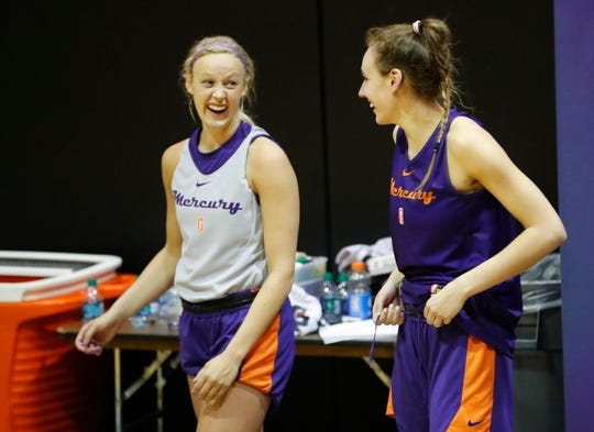 Phoenix Mercury's Sophie Cunningham (left) talks with teammate Alanna Smith during training camp in Phoenix on May 5, 2019.
