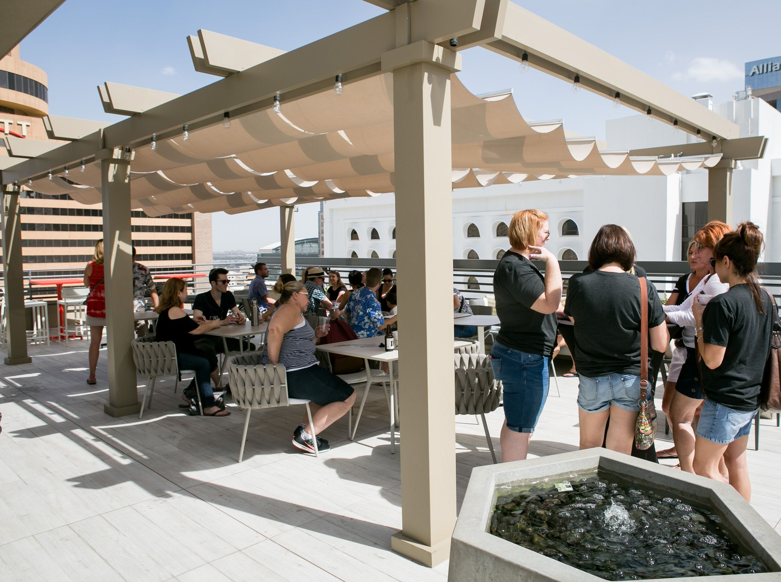 HAVE A DRINK AT A ROOFTOP BAR: Several Phoenix-area bars, including Floor 13 Rooftop Bar (pictured), around town offer a drink with a bird's eye view of the Valley.