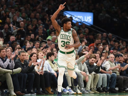 Apr 1, 2019; Boston, MA, USA; Boston Celtics guard Marcus Smart (36) reacts after making a basket during the first half against the Miami Heat at TD Garden. Mandatory Credit: Bob DeChiara-USA TODAY Sports