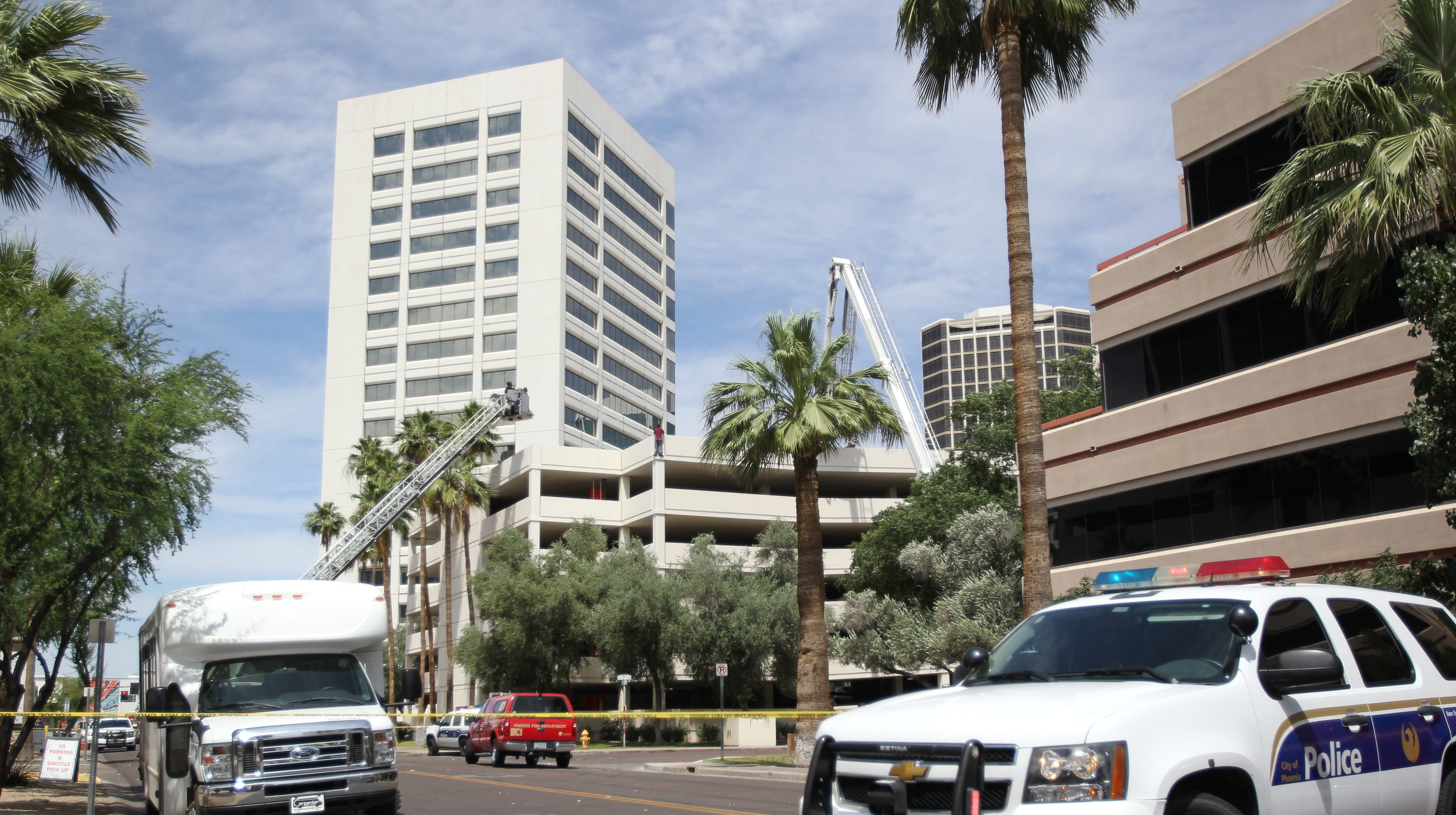 Phoenix Police Man In Crisis Atop Parking Garage Steps Down Safely