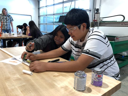 Havasupai Elementary School students Avery (right) and Chenell work on a class project at Canyon View High School.