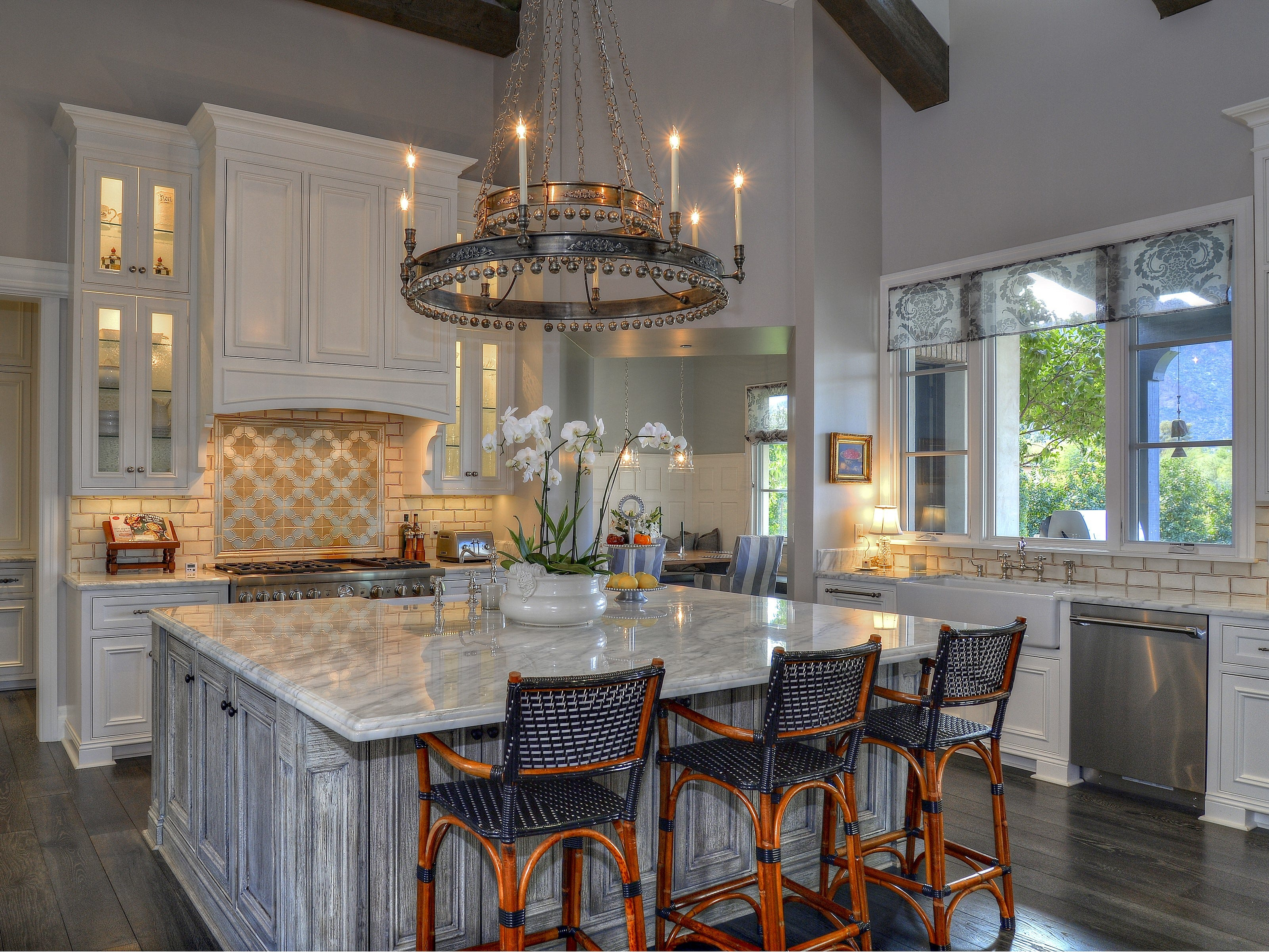 The Paradise Valley mansion, sold by Scott and Victoria Curtis, has a chef's kitchen that includes custom cabinetry and a large center island.