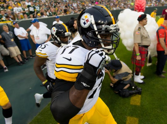 Steelers offensive tackle Marcus Gilbert (77) runs on the field prior to a game against the Packers at Lambeau Field.