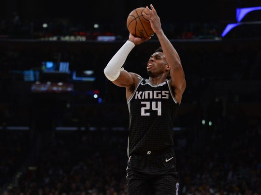 March 24, 2019; Los Angeles, CA, USA; Sacramento Kings guard Buddy Hield (24) scores a three point basket against the Los Angeles Lakers during the first half at Staples Center. Mandatory Credit: Gary A. Vasquez-USA TODAY Sports