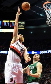 Jan 22, 2015; Portland, OR, USA; Portland Trail Blazers center Chris Kaman (35) shoots the ball over Boston Celtics center Tyler Zeller (44) during the first quarter of the game at the Moda Center at the Rose Quarter. Mandatory Credit: Steve Dykes-USA TODAY Sports