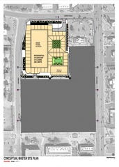 The conceptual site plan for a proposed five-story apartment complex in Gilbert's Heritage District on the southeast corner of Juniper Avenue and Ash Street.