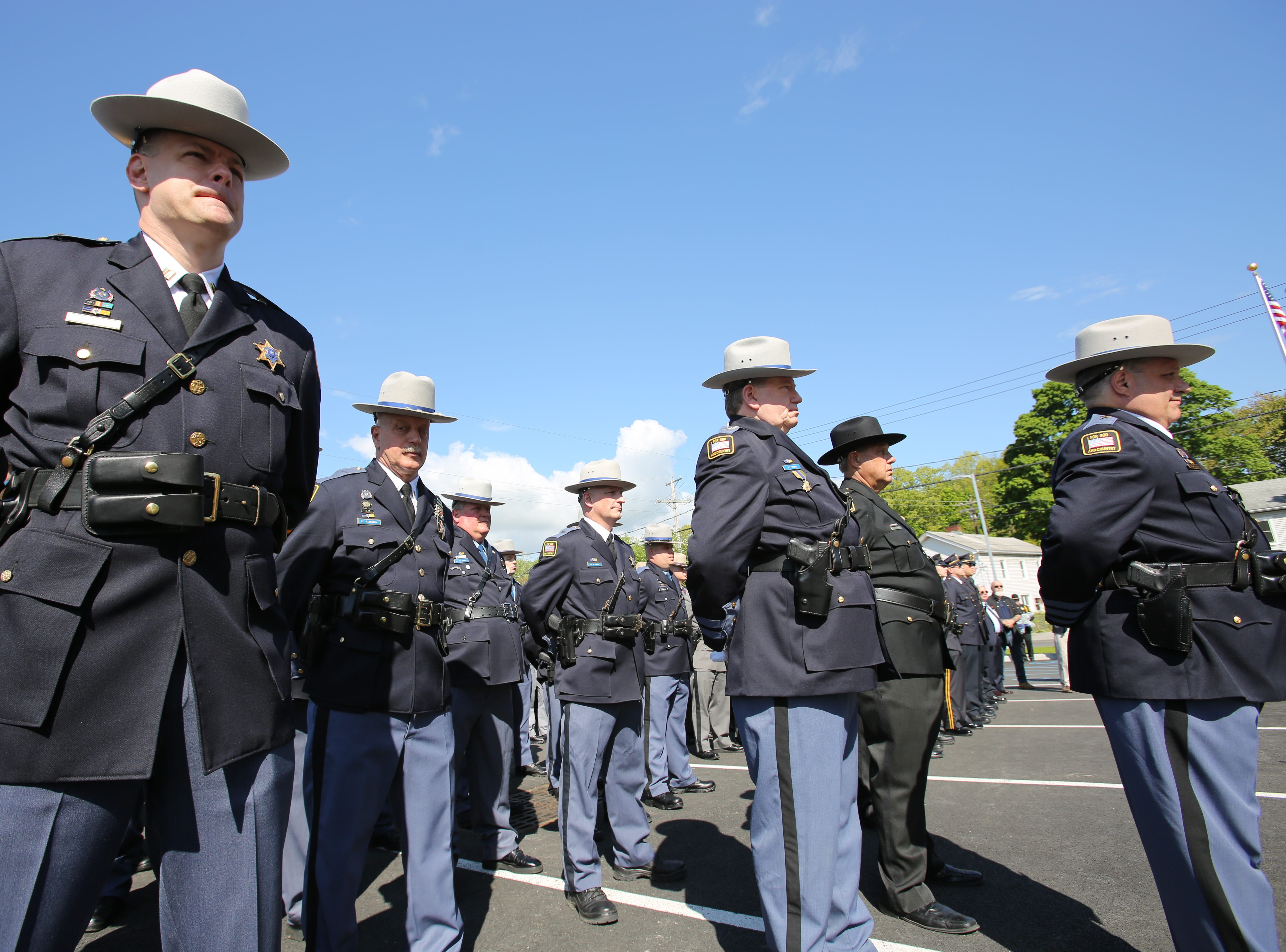 Dutchess County Sheriff's Office deputies stand in the parking lot of the sheriff's office on May 16, 2019 in observance of Memorial Day.