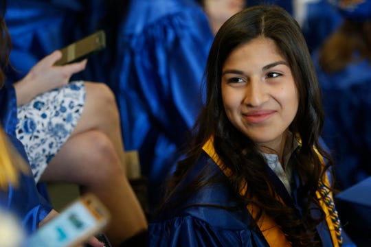 Dutchess Community College student Jennifer Hernandez of Pawling waits for Thursday's commencement ceremony begin on May 16, 2018