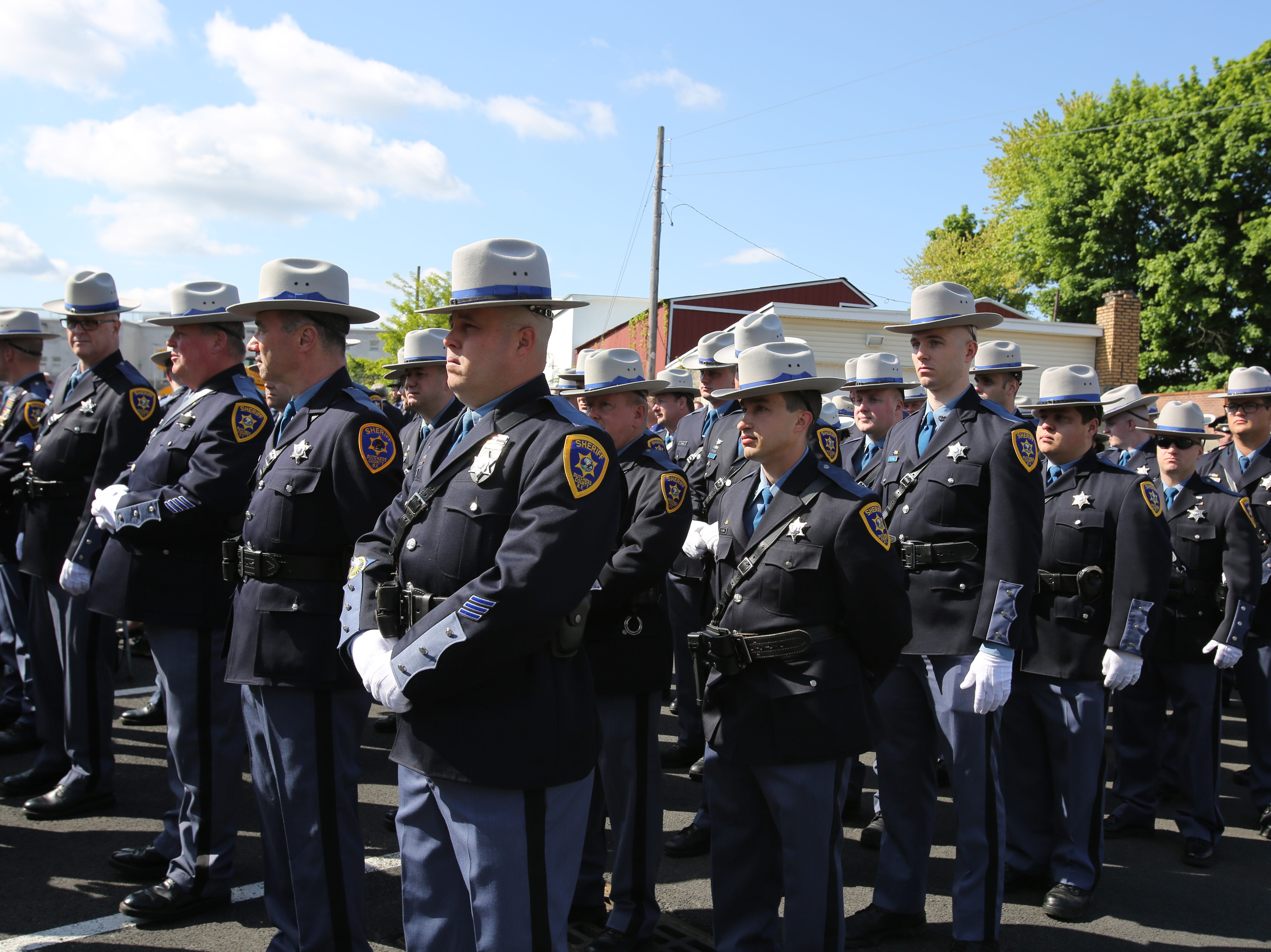 Dutchess County Sheriff's Office deputies stand and listen to Sheriff Butch Anderson speak about the sacrifices of law enforcement on May 16, 2019.