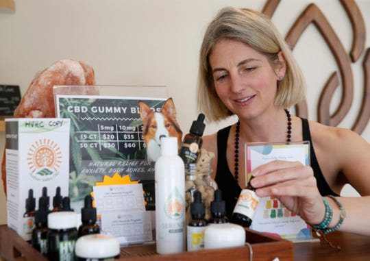 Elisa Gwilliam, founder of  the Hudson Valley Healing Center in the Town of Poughkeepsie arranges CBD products from Hudson Valley CBD offered for sale at the healing center on May 16, 2019.